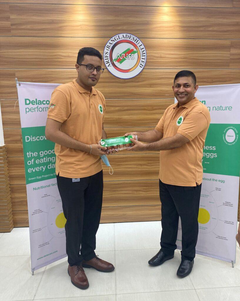 Delacon celebrating with distributor Arifs: Mr. Pronay Kumar Data (right, General Manager at Arifs Bangladesh) giving eggs to Marketing Officer Mr. Asik Iqbal Anik ©Delacon