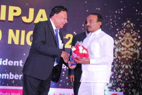 Shri Etela Rajender  receives bouquet from Mr Rana